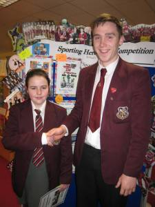 Year 8 pupil Aoibheann Murphy, winner of the Bookmark Competition with Ciaron O'Hanlon, her sporting hero and captain of the football team!