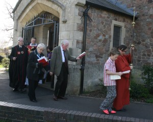 The Palm Sunday procession leaves the church