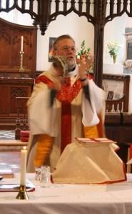 Tambourine-shaking vicar sings the Gloria