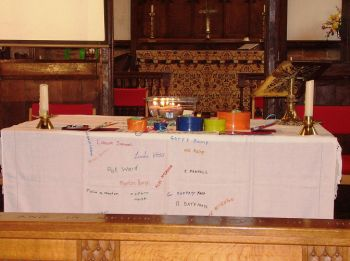 Photo of the communion table with examples of what we'd made during the day laid on it