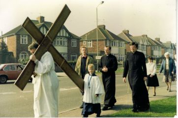 photo of the procession with Geoff carrying the cross