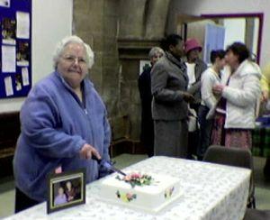 photo of Mavis cutting her cake
