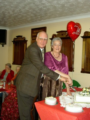 Photo: ... and cutting the cake at the Bowling Club