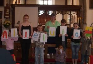 Photo: The children show us their Alleluia art