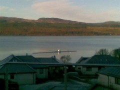 The pontoon arrives in Strachur having been towed from Cairndow