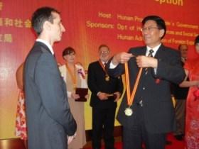 Adam receiving his award
