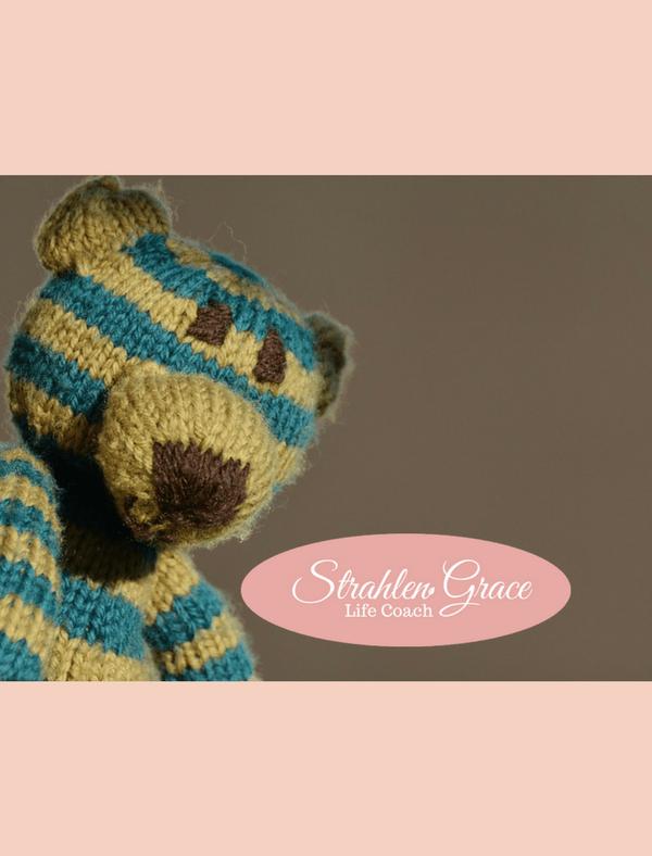 Teddy Bear alone leaning on brick wall