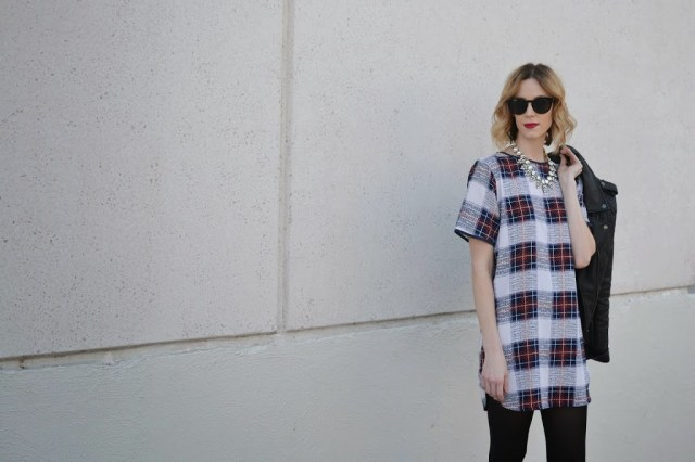 plaid shift dress, leather moto jacket, tights, boots, crystal necklace