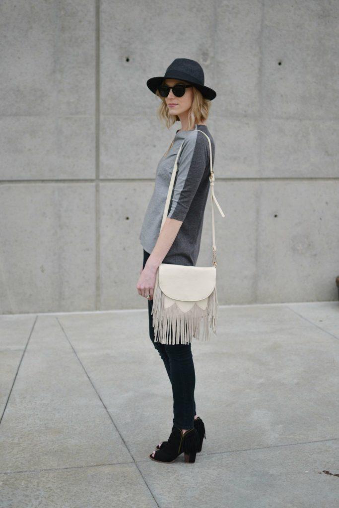 grey top, black jeans, fringe bag 1