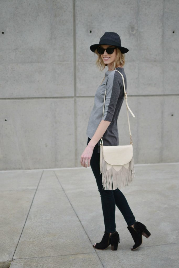 grey top, black jeans, fringe bag, fringe booties, hat