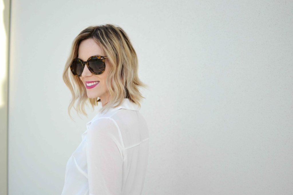 striped skirt, white blouse, karen walker sunglasses closeup 1