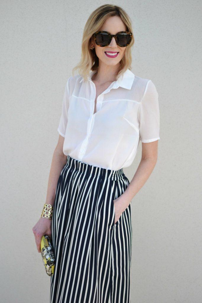 striped skirt, white blouse, karen walker sunglasses, floral clutch