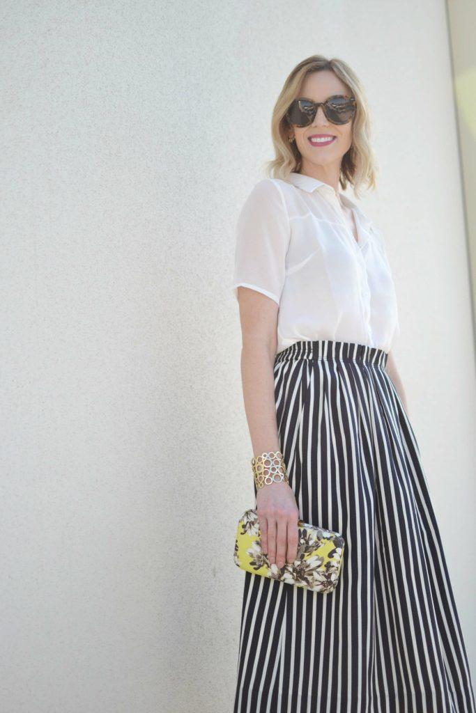 striped skirt, white blouse, karen walker sunglasses