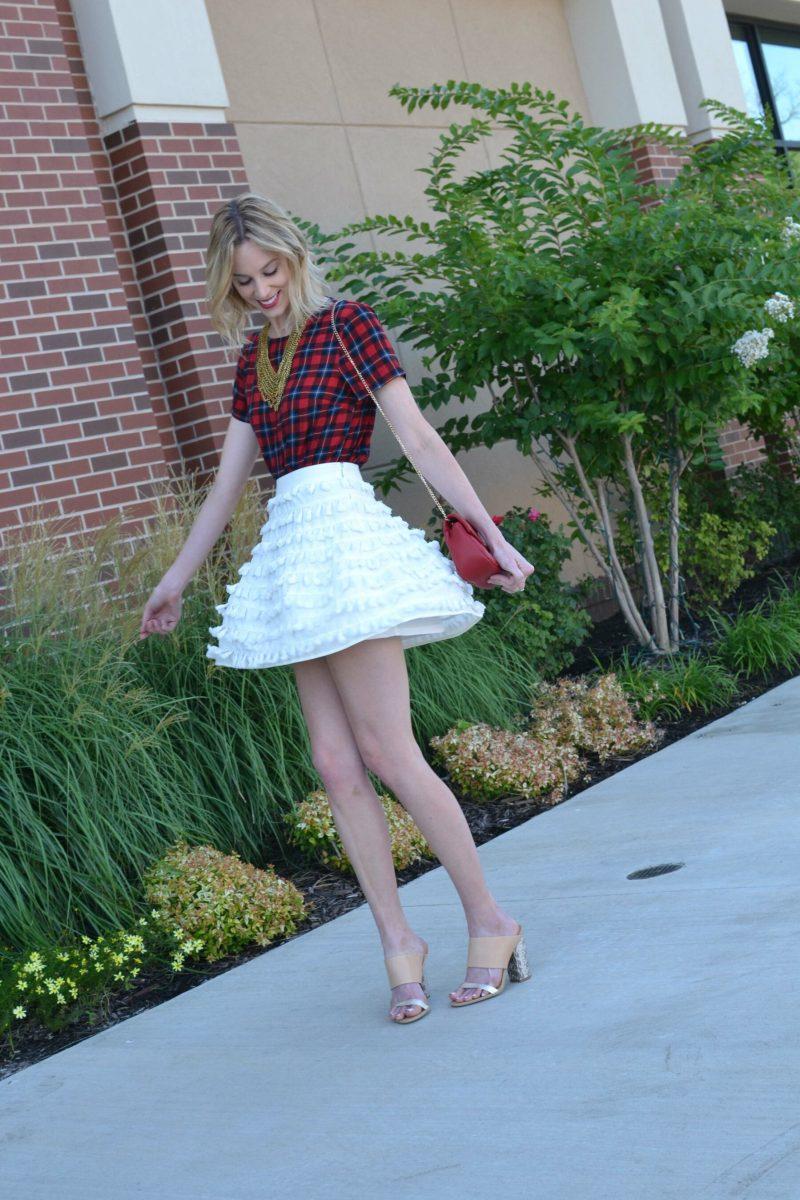 Maude tassel skirt, palid shirt, mules, twirling