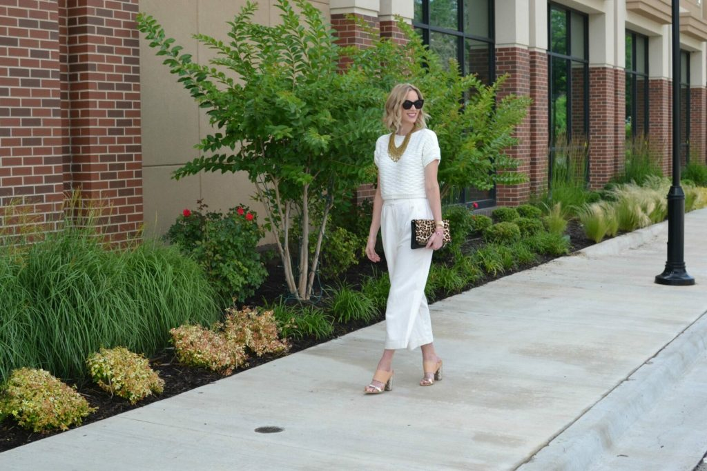 cream culottes, cream crop, mules, gold bib necklace, leopard clutch