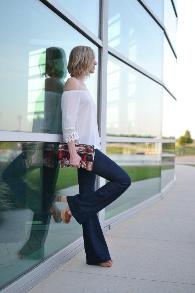 flare jeans, white off the shoulder top, platforms