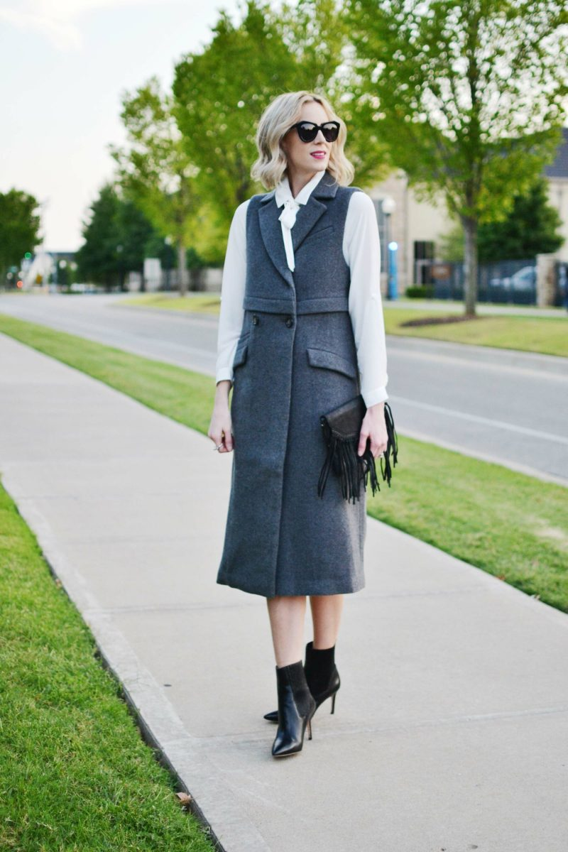 free people vest, bow blouse, black heeled booties, fringe bag