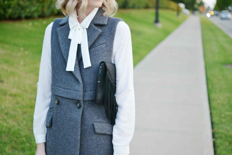 free people vest, bow blouse, fringe bag