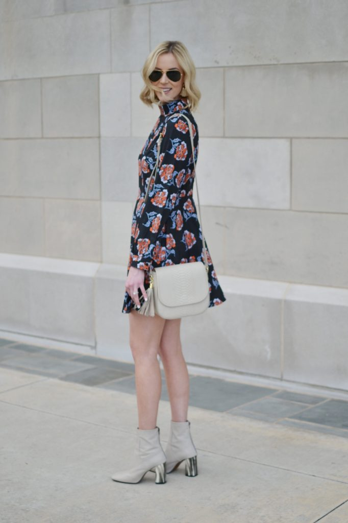 floral mini dress, cream boots, GiGi New York Kelly Saddle bag in bone, Ray-Ban aviators, nude lipstick