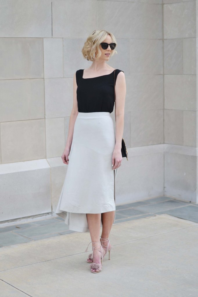 classic pieces with BYOND, blush pom pom heels, black top, grey suede skirt, asymmetrical