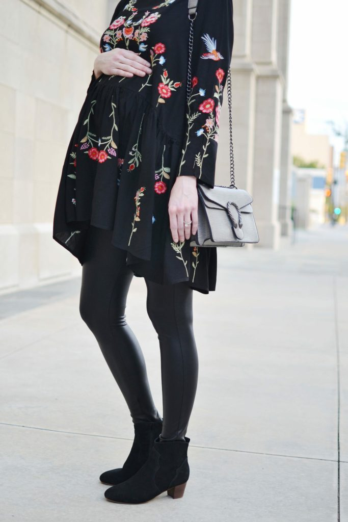 embroidered black tunic, faux leather leggings, black ankle booties, fall outfit idea, stylish maternity outfit