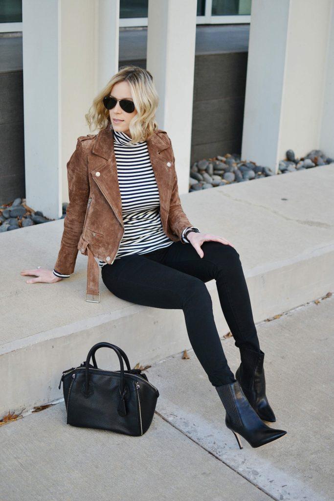 building your wardrobe with classic pieces - striped turtleneck, black denim, black boots, suede moto jacket