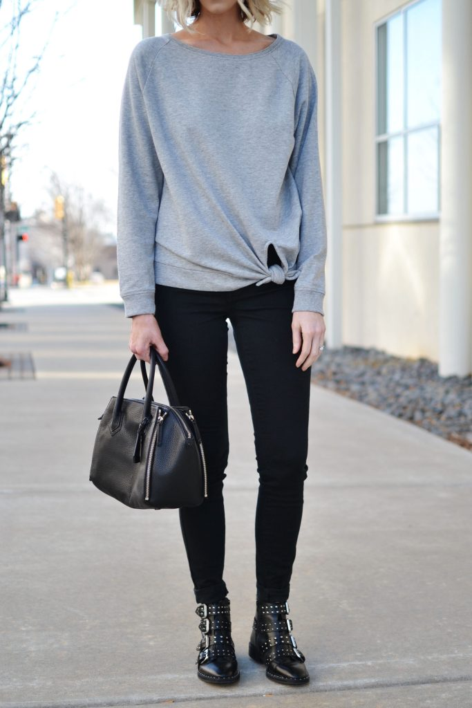 black and grey knotted grey sweatshirt, black jeans, buckle boots, casual jeans outfit
