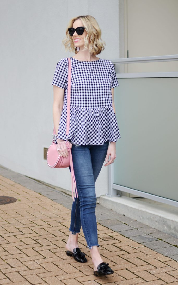gingham bow back top, distressed denim, tassel mule loafers, pink rebecca minkoff unlined saddle bag, spring outfit idea