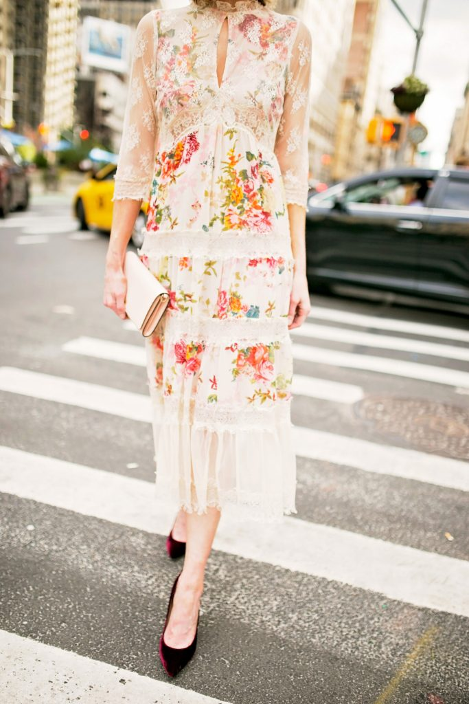 floral and lace midi dress with velvet heels and blush clutch, dressy outfit, street style photo