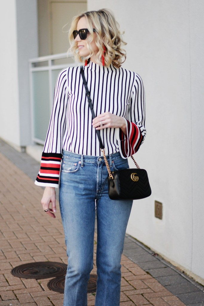 mom style straight leg jeans with striped bell sleeve top, black sunglasses and black gucci marmont bag