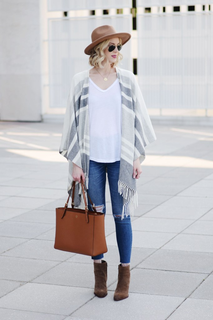 how to style a poncho with jeans, casual poncho outfit styling, distressed denim, booties, hat