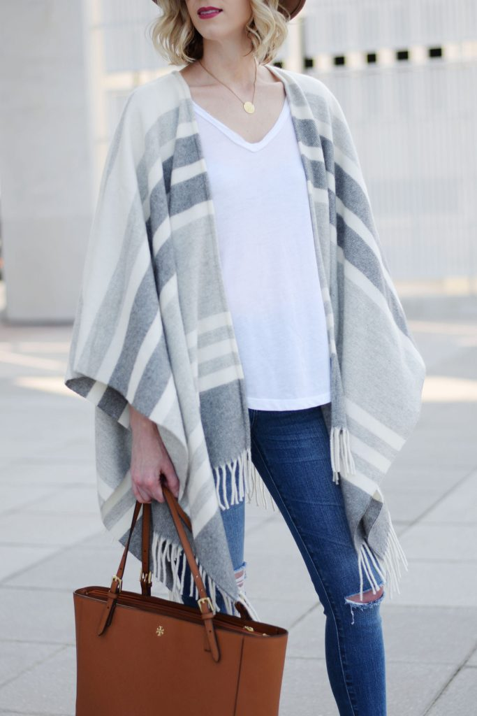 striped grey poncho with fringe, distressed denim, white t-shirt