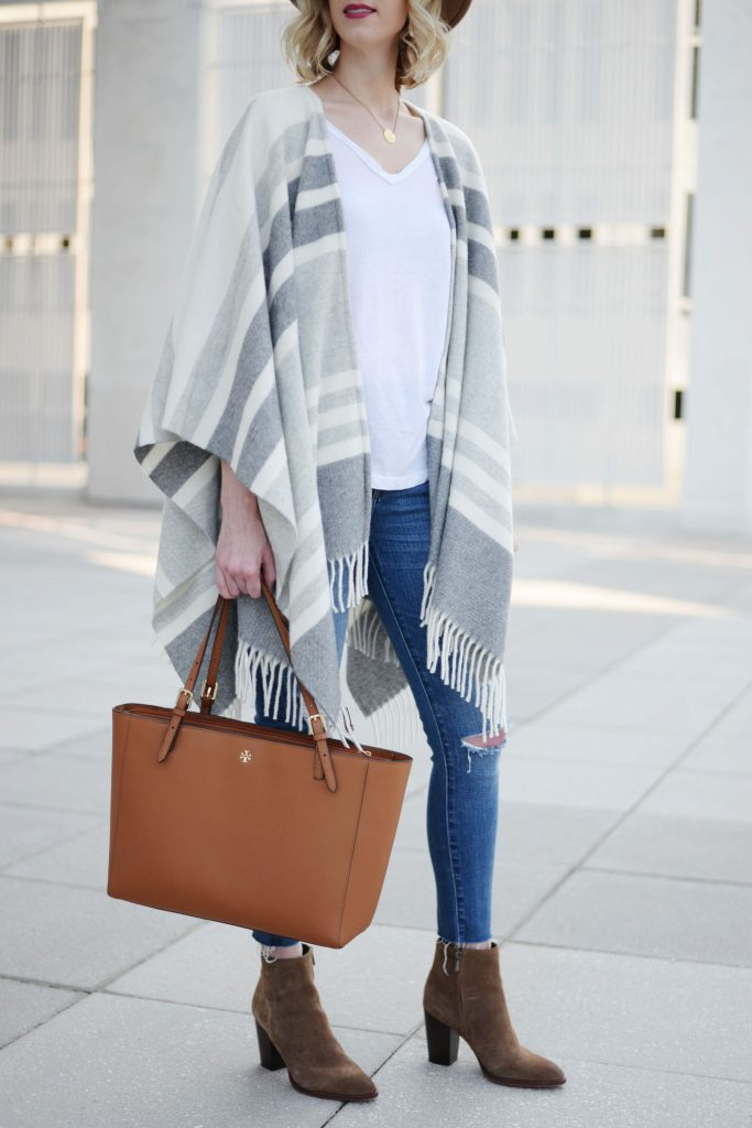 poncho worn with jeans and ankle booties