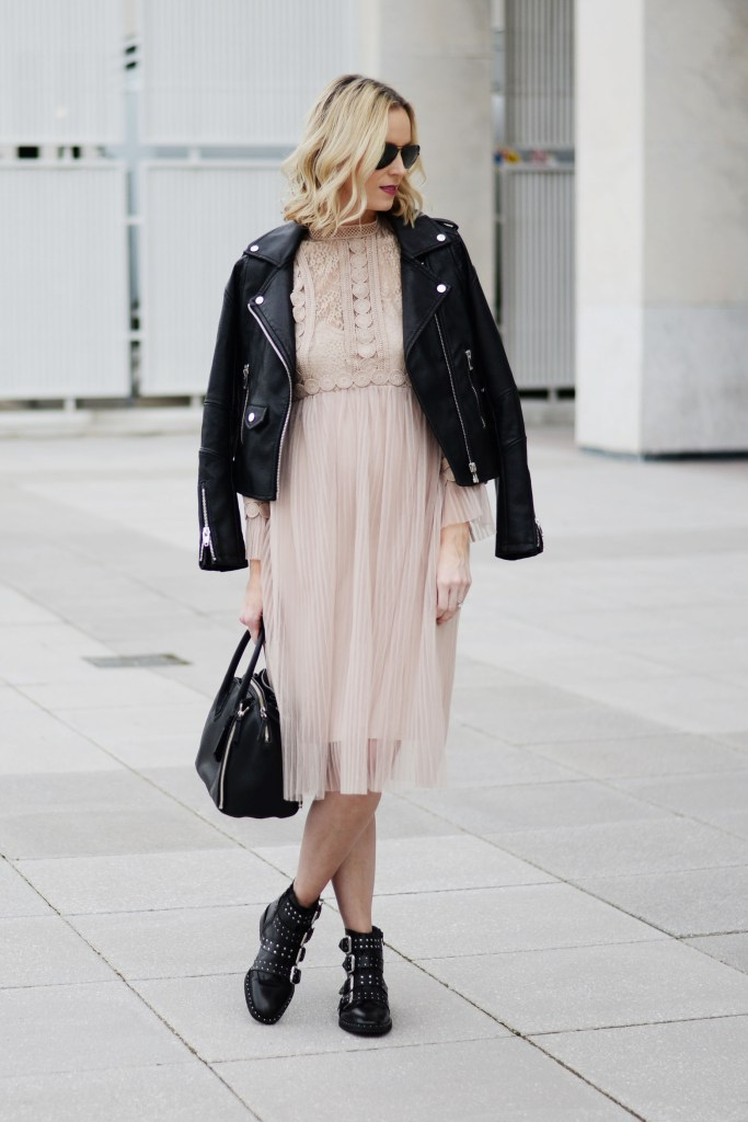 nude tulle dress with black leather jacket and black boots