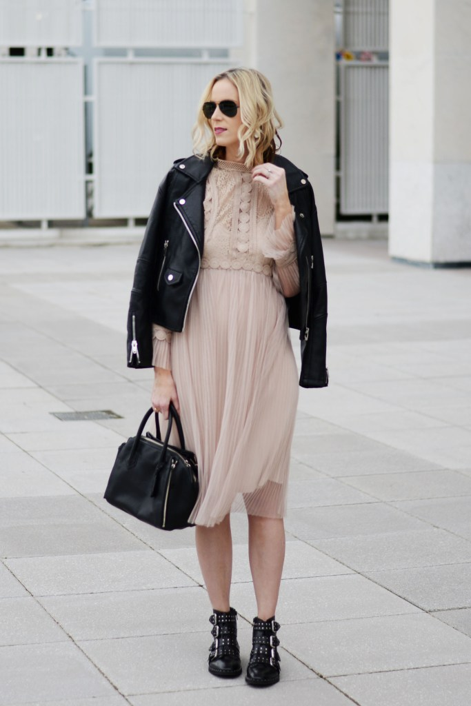 feminine and edgy outfit combination, tulle dress with leather moto jacket and boots