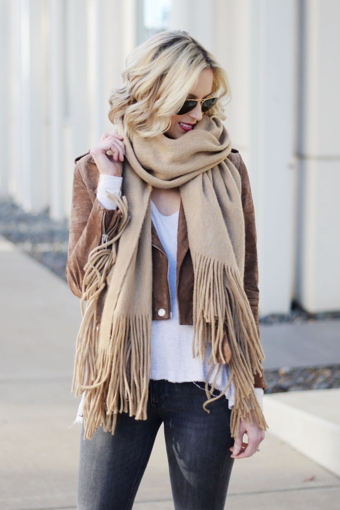 tan suede moto jacket, tan scarf, cream thermal top, grey jeans