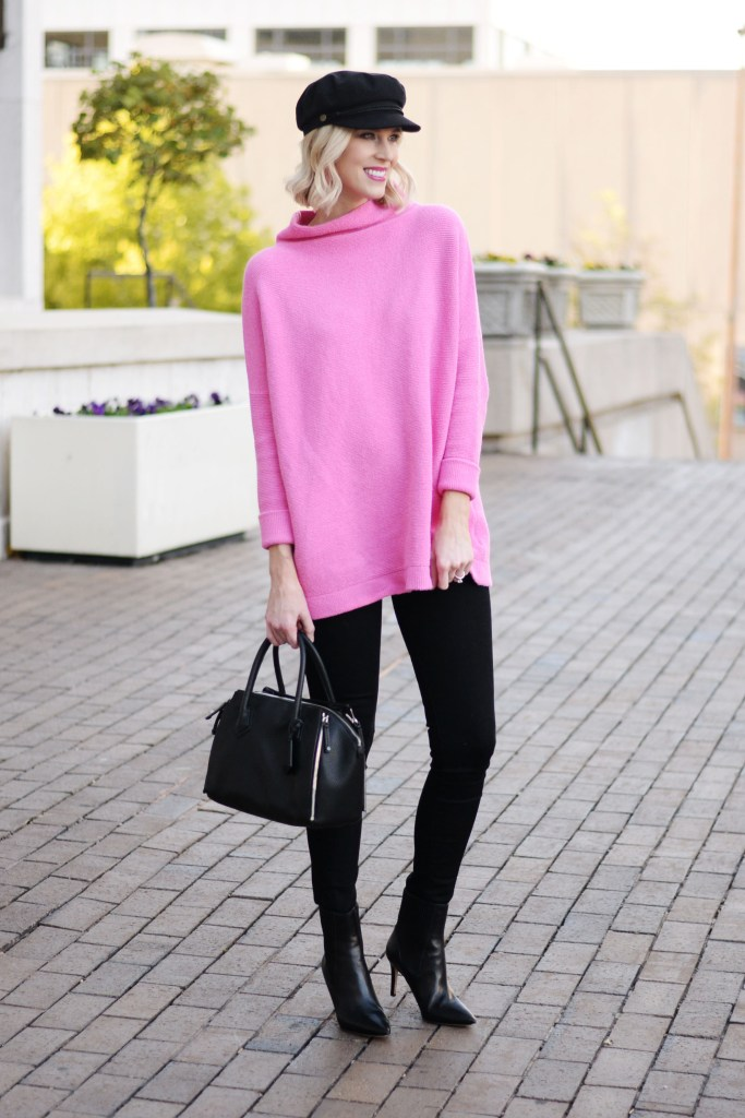 hot pink tunic length sweater with jeans and hat