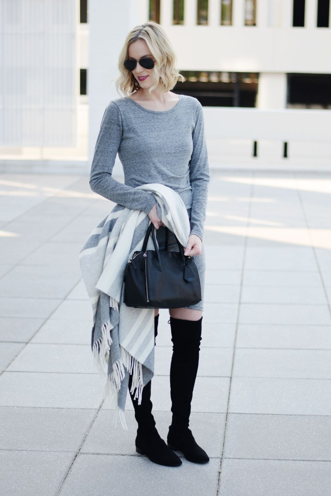 grey bodycon dress with over the knee boots and draped poncho