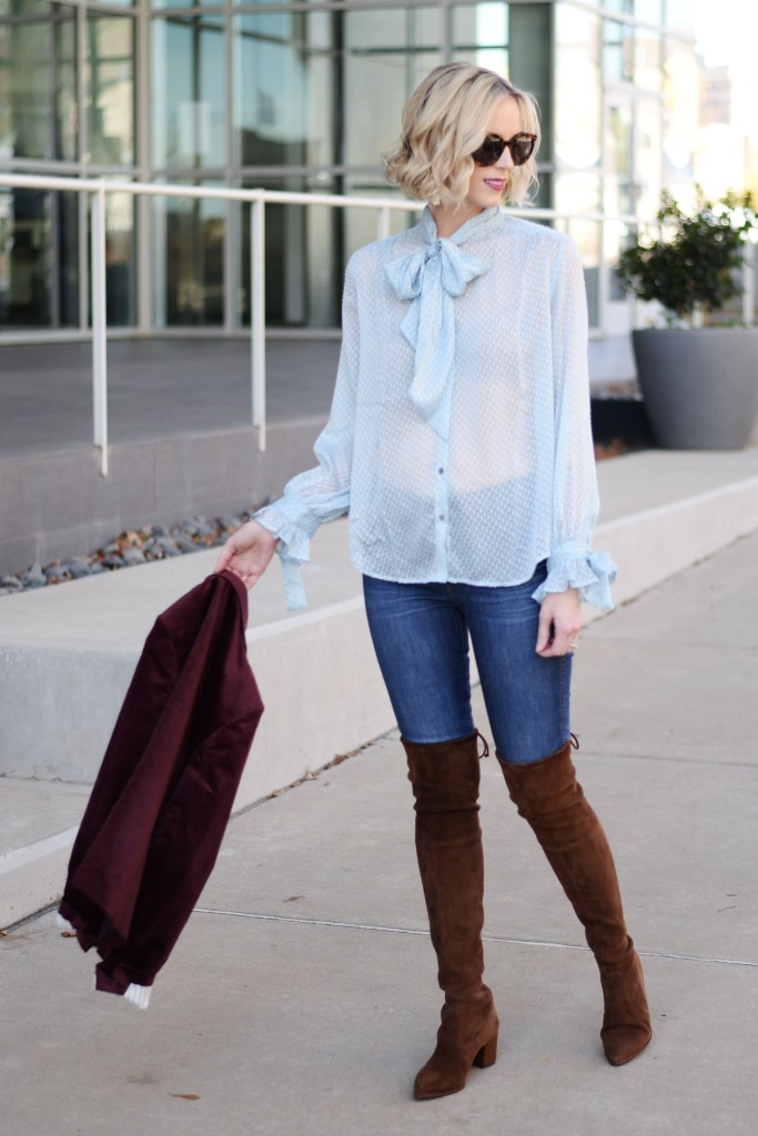 sheer baby blue dot tie front blouse with jeans and over the knee boots