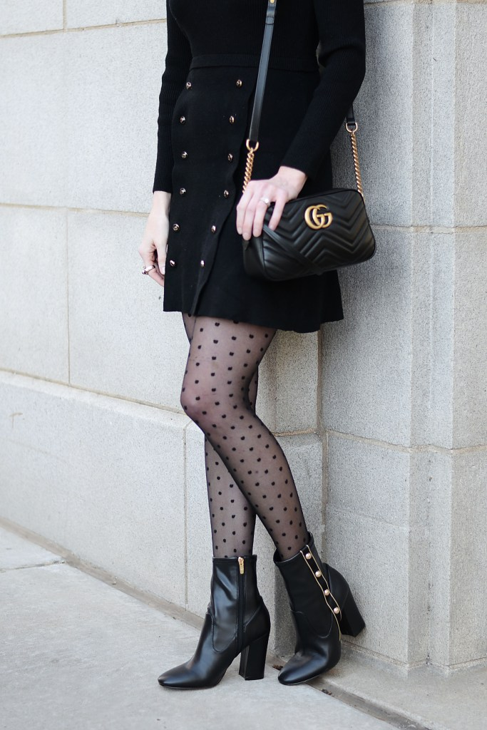 black sweater dress with gold buttons, polka dot tights, black boots with gold buttons, black gucci marmont bag