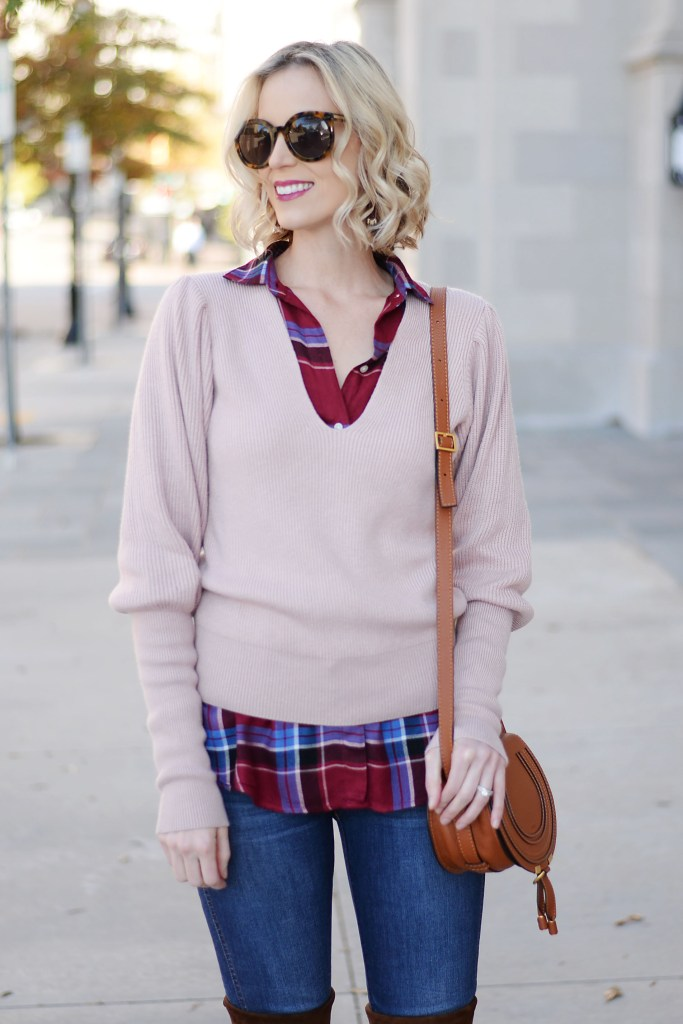 rose pink sweater over burgundy plaid top with jeans