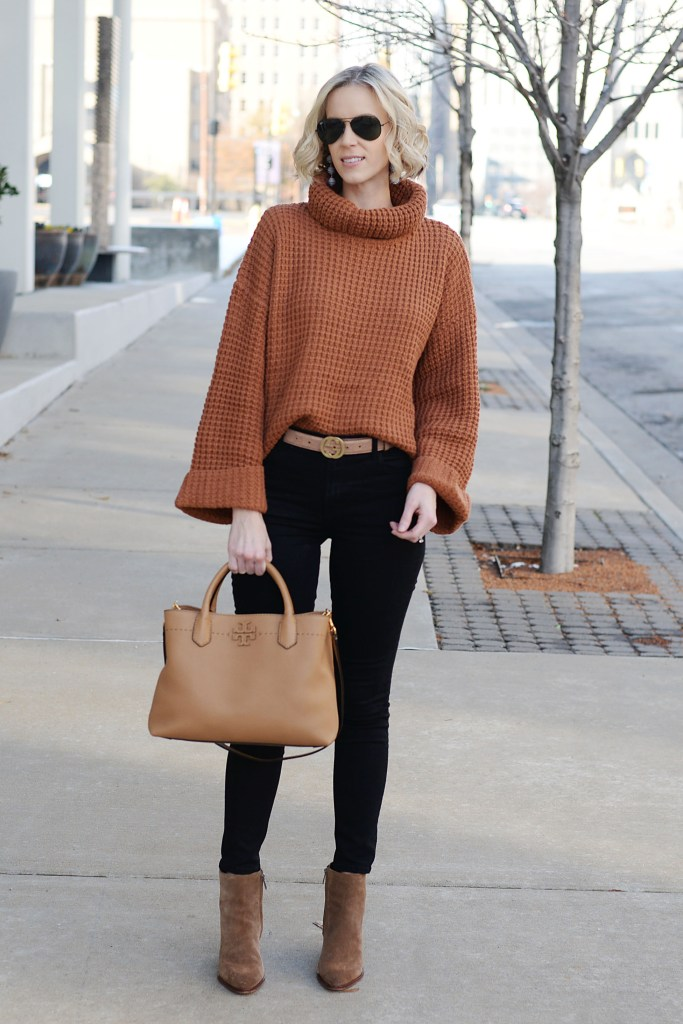 cozy sweater with jeans and boots