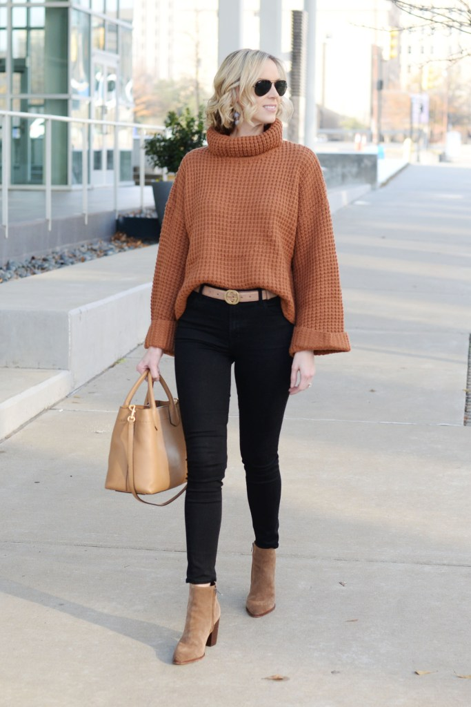 black jeans with tan sweater and accents, black and brown outfit