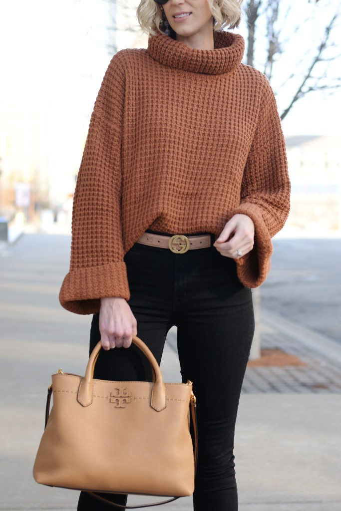 tan waffle knit sweater with black jeans and tan accents