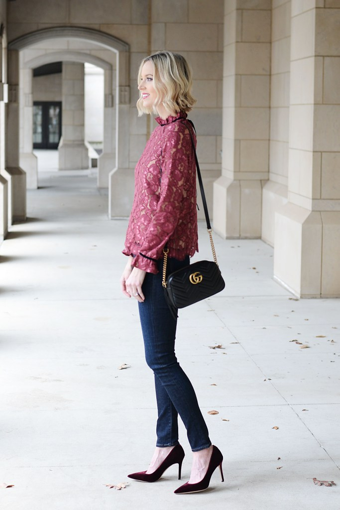 berry colored lace blouse with dark skinny jeans and heels
