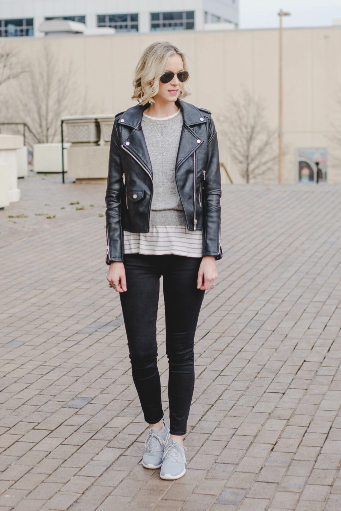 leather jacket outfit, sweater layered over striped t-shirt, nike roshe sneakers with jeans