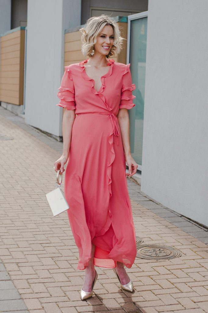 long coral dress perfect for spring with gold accessories