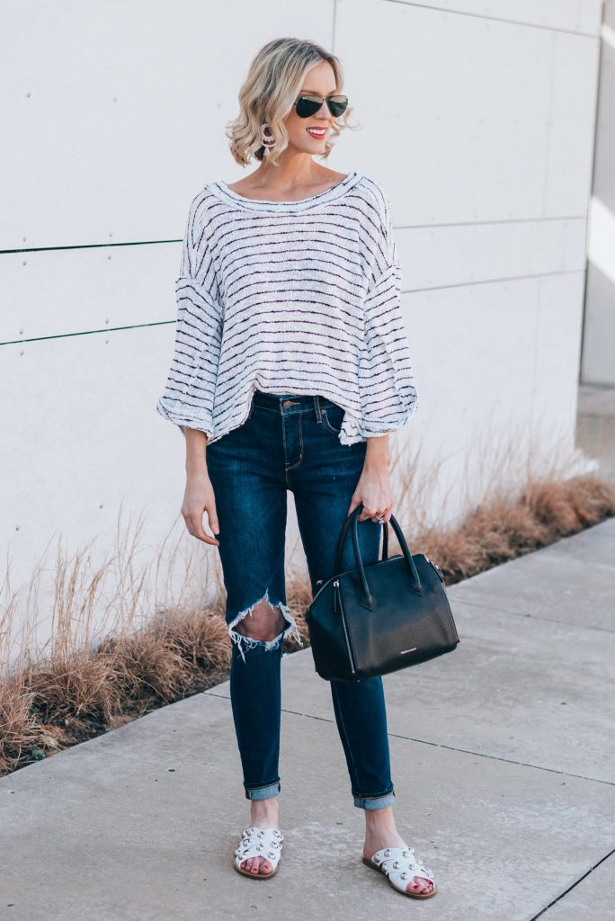 white top with black stripes and white studded sandals