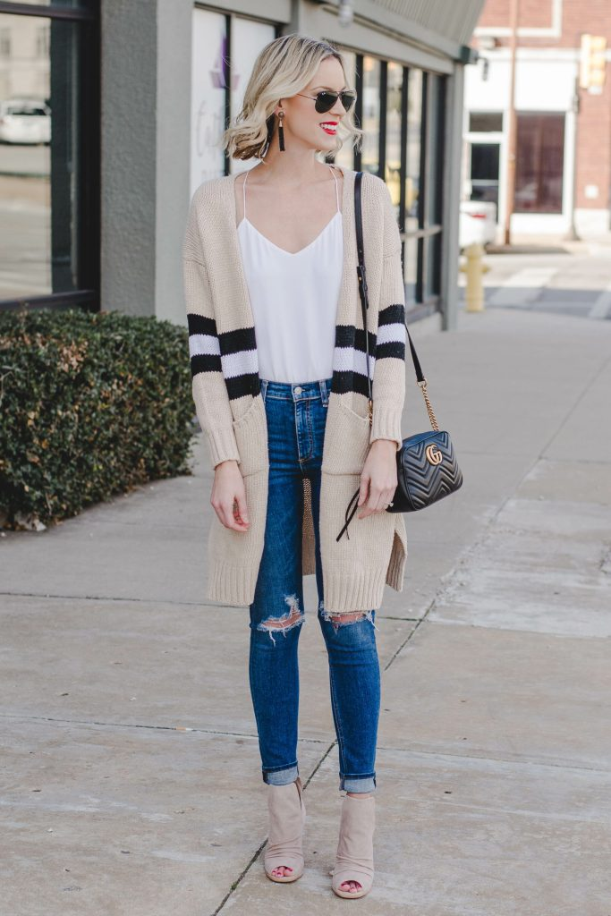 tan, black, and white cardigan with white cami and jeans