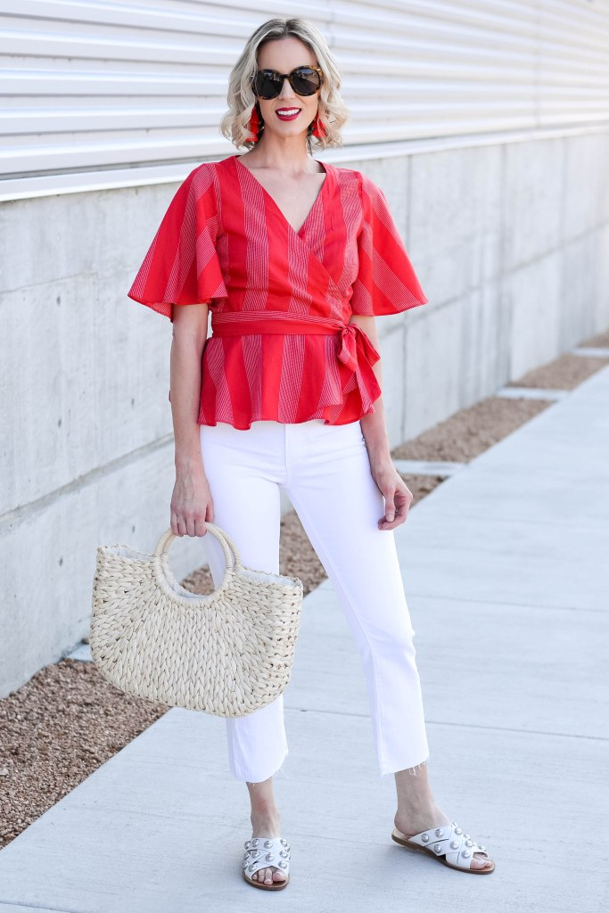 white jeans with wrap style tie waist top